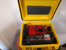 it has a pair of 10ah sla batteries two 12v ports two usb charging ports and an integrated 4a charger just plug in an extension cord and it s all set