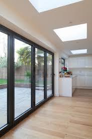 Rear flat roof extension | Black aluminium bi-fold doors to open ...