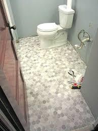 how to cut vinyl plank flooring around toilet how to install a sheet vinyl floor a