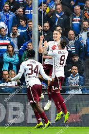 Torinos forward Andrea Belotti C celebrates teammate ...
