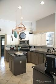 sherwin williams paint for kitchen cabinets snowbound on the top cabinets gauntlet gray on the lowers