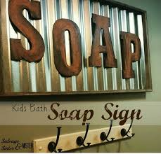 diy corrugated metal and wood letters bathroom sign by salvaged sister and mister