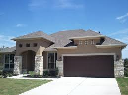 dark brown garage doorsCookieCutter Houses  Austin TX New Home Construction  Bee cave