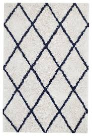 ivory area rug with navy diamonds from houzz