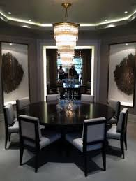 the dining room at 181 davenport gilded bronze gl c sculptures in the niches and a vine light fixture