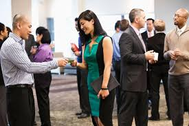 top career networking tips for college students exchanging business cards at conference