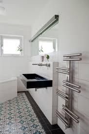 modern bathroom towel bars.  Bathroom Modern Bathroom Decor Using Artsy Towel Rack From Steel Bar And Rail Next  To Floating Black Sink On White Backsplash Bars T