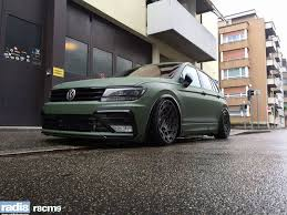 2018 volkswagen tiguan black. simple black the army green wrap is set up by various gloss black accents that include  the air intakes of front bumper radiator grille wheel arch extensions  with 2018 volkswagen tiguan