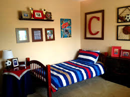 Sports Decor For Boys Bedroom Red Blue Sports Themed Boys Bedroom With Blue Stripes Pillow And
