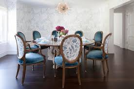 round french dining table with blue velvet oval back dining chairs on oval back