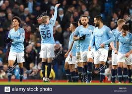 Manchester City's Oleksandr Zinchenko celebrates scoring his side's fourth  goal of the game with team-mates during the Carabao Cup, semi final match  at the Etihad Stadium, Manchester Stock Photo - Alamy