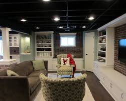 exposed ceiling lighting basement industrial black. semifinished basement room sized carpet ikea bookcases paint ceiling black exposed lighting industrial s