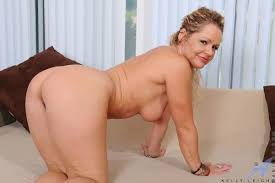 The pussy of blonde milf Kelly Leigh getting fully filled with her.
