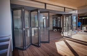 how do bifold or bi fold doors and windows work