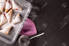 Baking Tray With Fresh Pastry On The Kitchen Table Stock Photo