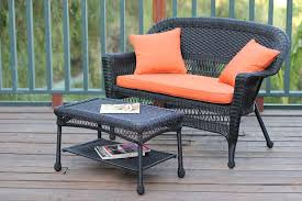 black wicker patio love seat and coffee