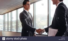 The Office The Merger Business Men Handshake After An Agreement In The Office Greeting