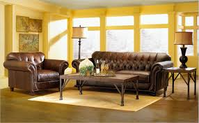 brown living room rugs. Dark Brown Leather Tufted Sofa Combined With Rectangle Wooden Table On The Cream Rug Plus Living Room Rugs N