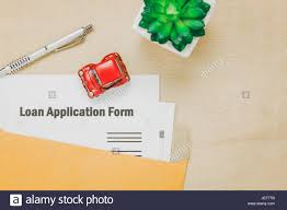 top view business office desk background the business loan appcation form pencil letter and car