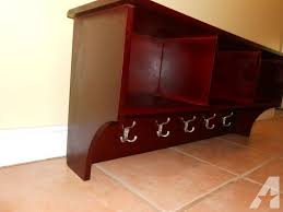 cherry wood wall shelf with hooks cubbies