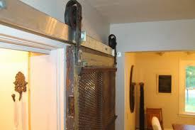 sliding barn door for pantry using old meat hooks, Girl Meets Carpenter on  @Remodelaholic