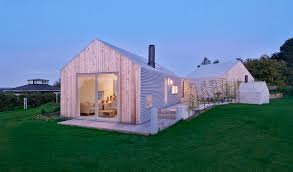 five small buildings and a shared courtyard create a stunning summerhouse in denmark