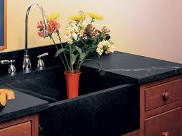 a vermont soapstone oiled sink is nearly black with the light veins in high contrast