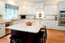 new venetian gold granite countertops white cabinets dark island wood flooring