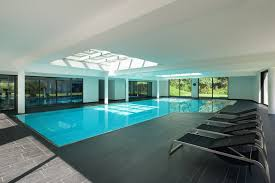 Indoor swimming pool design Ceiling This Is True Example Of An Indoor Pool That Has Everything Huge Simple White Home Stratosphere 52 Cool Indoor Pool Ideas And Designs photos