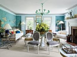 The living room decor is centered on a circa-1930 Italian green-glass  chandelier