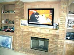 installing tv over brick fireplace post mounting flat screen above hiding wires hang