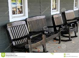 wooden rocking chairs for front porch.  Chairs Four Wood Rocking Chairs On Front Porch Dark Set  With Wooden Rocking Chairs For Front Porch