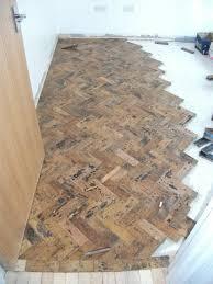 flooring being glued down in herringbone fashion