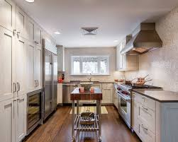 Inspiration For A Contemporary U Shaped Enclosed Kitchen Remodel In Denver  With Stainless Steel Appliances