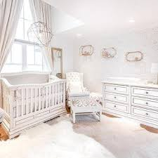 white and gray girls nursery with light gray cowhide rug