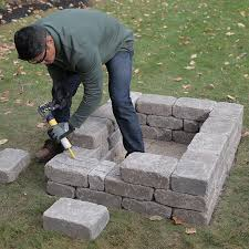 laying third row of retaining wall blocks