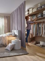 Hidden Closet With Curtain In The Bedroom