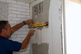 usually i cut the backerboard to the exact edge of the layout line planning for the niche tile to