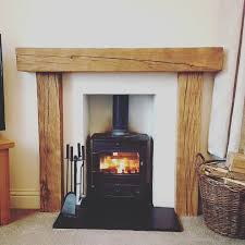 we can also offer full fire surrounds this beautiful rustic fireplace surround is from old seasoned oak hand worked and waxed to a stunning finish