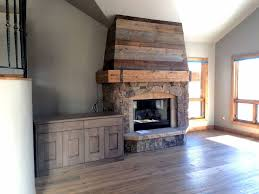 We simply added reclaimed wood to the drywall above the fireplace and put  in a new