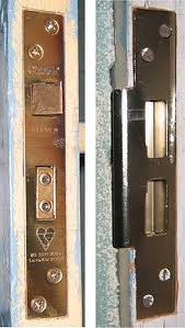 the two main parts of a mortise lock left the lock body installed in the thickness of a door this one has two bolts a sprung latch at the top