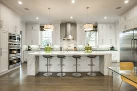 transitional kitchen lighting. a transitional kitchen usually consists of simple wood cabinetry sleek handles and natural surfaces such as marble granite or limestone lighting i