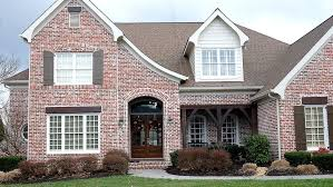 exterior white trim and stained wood trim on a brick house residential painting by nash