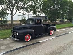 flat black paint ford pickup in a perfectly smooth flat black paint job and rolling on