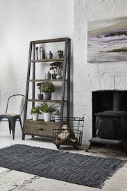 modern metal furniture. Mix Natural, Rustic Furniture With Cool Coloured Accessories And Modern Metal Accents To Create An On-trend Urban Cabin Feel. Click For More Ideas.