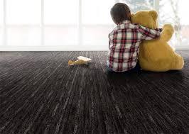 child playing on wool carpet earthweave s biofloor wool carpets