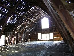 inside barn hay. filtered light inside old barn hay