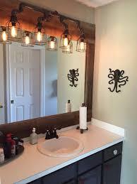 vanity lighting for industrial bathroom black pipe wall