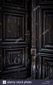 mysterious and old dark door partially opened Stock Photo: 169097216 ...