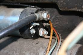 massey ferguson 135 electrical woes the yellow line is the line from the alternator running by the solenoid up to the ammeter the top is the positive battery and the bottom goes to the